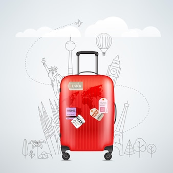 色の赤いプラスチックの旅行かばん