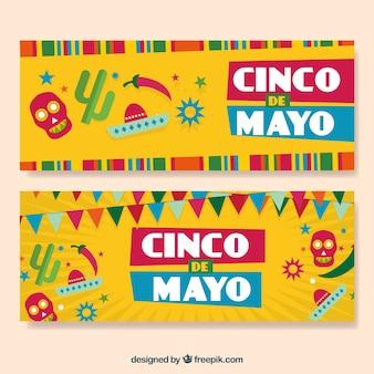 Cinco de mayoのための頭蓋骨とガーランドの色付きのバナー