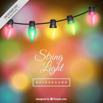 Colored bokeh background with string lights