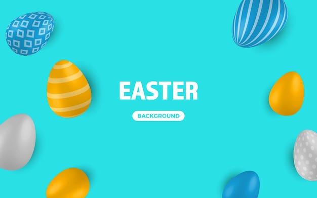파란색 배경에 색된 부활절 달걀입니다.