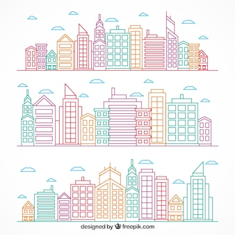 Colored hand drawn modern cities set