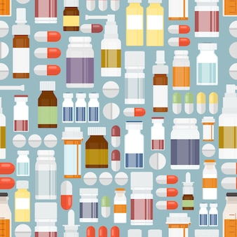 背景デザインのためのシームレスなパターンの着色された丸薬と薬。