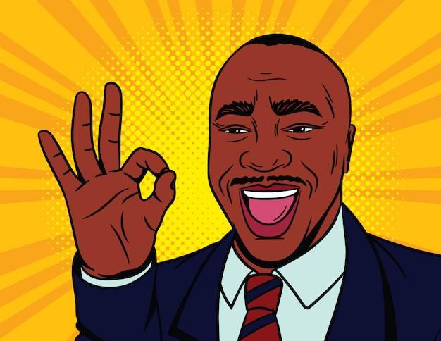 ポップなアートコミックスタイルの色ベクトルイラスト。承認された記号で幸せな男性の顔。アフリカ系アメリカ人の男は彼のジェスチャーとの合意を示しています