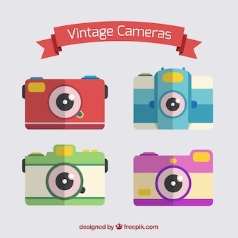 Colored vintage cameras set in flat design