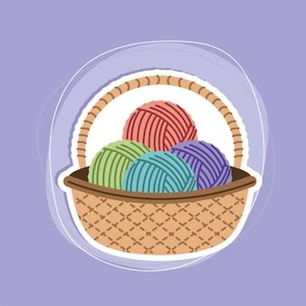 Цветные шарики пряжи в корзине
