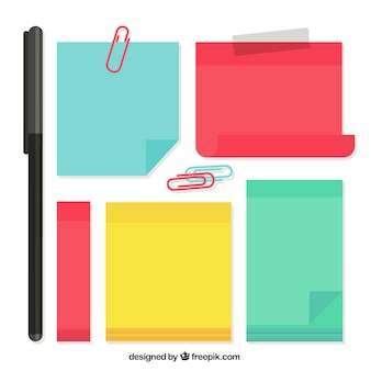 Colorful adhesive notes with some clips and pen