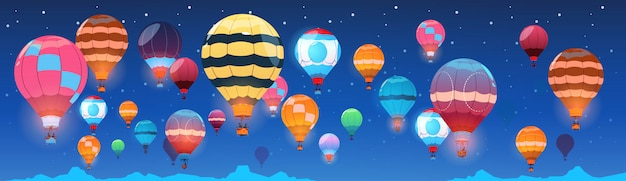 Colorful air balloons flying in night sky banner