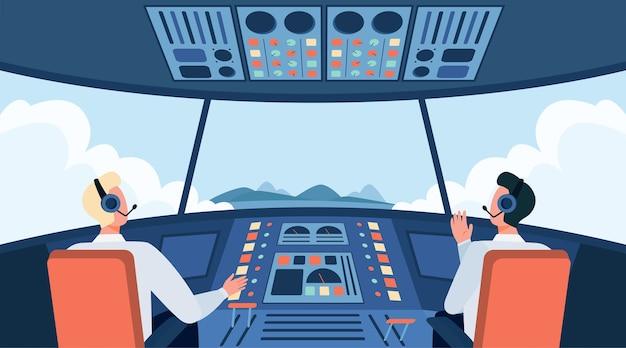 カラフルな飛行機のコックピットは、フラットベクトルイラストを分離しました。コントロールパネルの前の飛行機のキャビン内に座っている2人の漫画のパイロット。乗務員と航空機のコンセプト