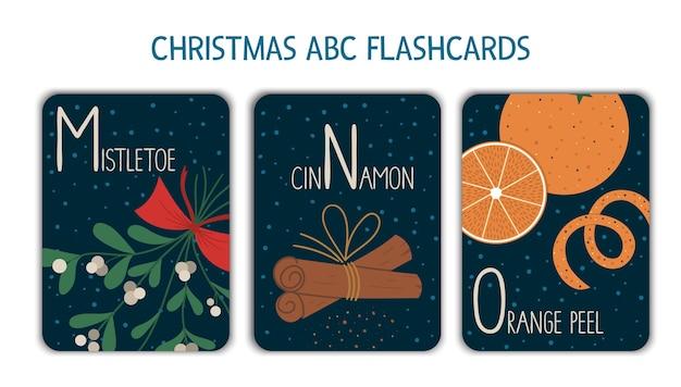 カラフルなアルファベット文字m、n、o。フォニックスのフラッシュカード。面白いヤドリギ、シナモン、オレンジの皮で読書を教えるためのかわいいクリスマスをテーマにしたabcカード。新年のお祭り活動。