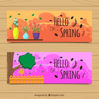 Colorful banners with flowerpots and tree