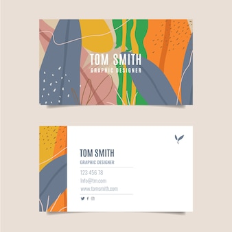 Colorful business card with tropical leaves