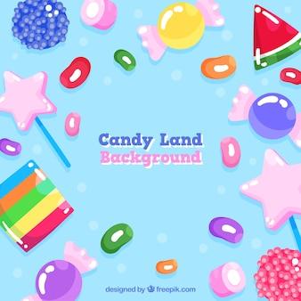 手描きのスタイルでカラフルなキャンデーの土地の背景