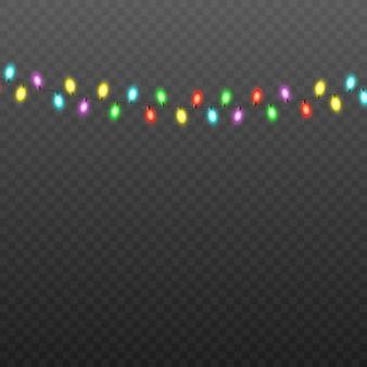 黒の半透明のカラフルなクリスマスライトの文字列
