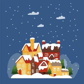 雪の降る冬の夜に古い建物のある小さな町にあるさまざまなサイズの家のあるカラフルでかわいい街...