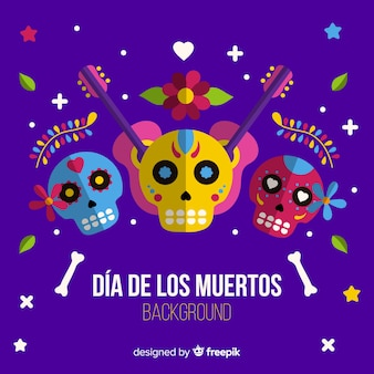 Colorful día de muertos wit mexican skull background in flat design