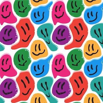 カラフルな歪んだ笑顔の絵文字パターン