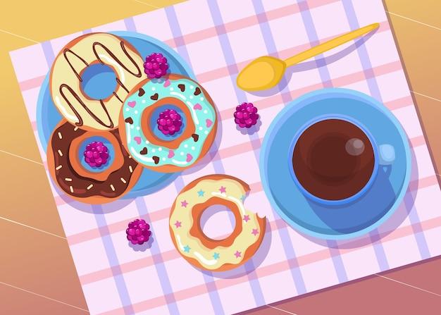 コーヒーやお茶のイラストとプレート上のカラフルなドーナツ