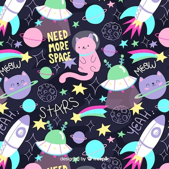 Colorful doodle cats in the space and words pattern