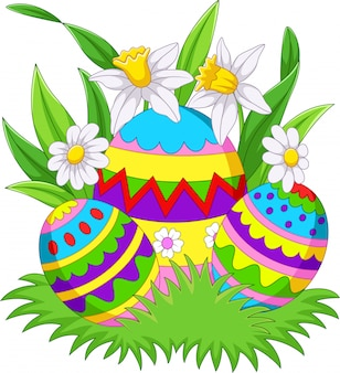 Colorful easter eggs background on the grass