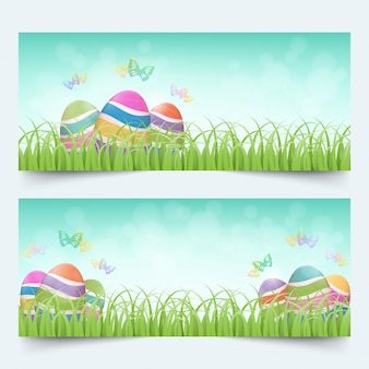 Colorful easter eggs with butterflies in grass field banners set