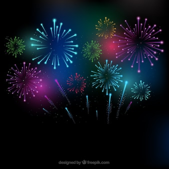 Colorful fireworks background Free Vector