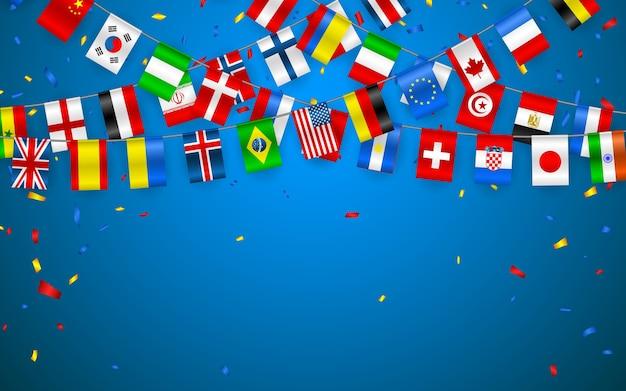 紙吹雪でヨーロッパと世界のさまざまな国のカラフルな旗の花輪。国際ペナントのお祭りの花輪。バンティングリース。お祝いパーティー、会議のバナー。