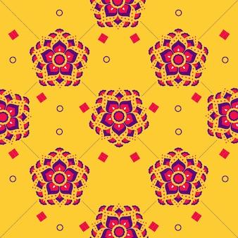 黄色の十字形の十字パターンの背景に飾られたカラフルな花。