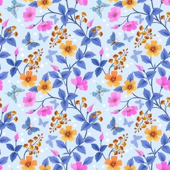 カラフルな花と蝶のシームレスなパターン