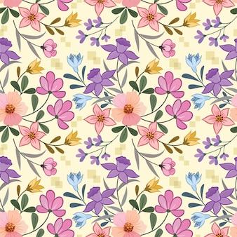 ファブリックテキスタイル壁紙用のカラフルな花のシームレスパターン。