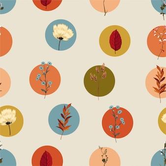 植物や野生の花のレトロなスタイルのシームレスなパターンを持つカラフルな幾何学的な円