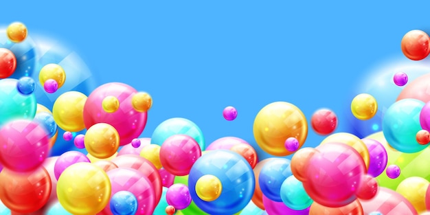 Colorful glossy candy balls on yellow background