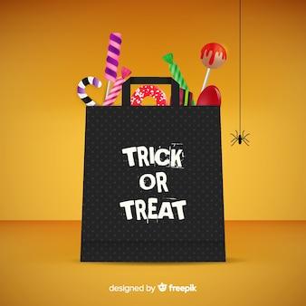 평면 디자인에 화려한 할로윈 사탕 가방 배경