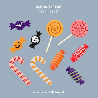 Красочная коллекция конфет хэллоуина в плоском дизайне