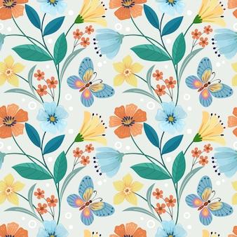 カラフルな手描きの花と蝶のシームレスパターン