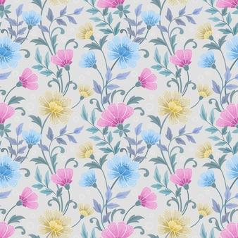 カラフルな手描きの花を青い色のシームレスなパターンで描く