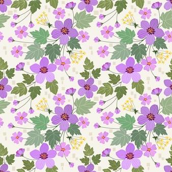 カラフルな手は、紫の花と緑の葉のシームレスなパターンを生地織物壁紙に描画します。