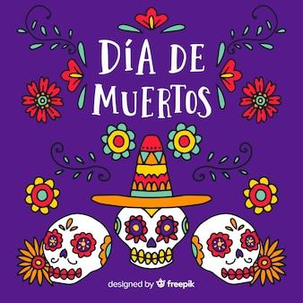 Colorful hand drawn día de muertos background