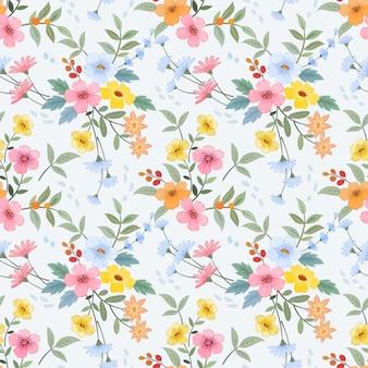 カラフルな手描きの花のシームレスなパターンは、織物繊維の壁紙に使用できます。