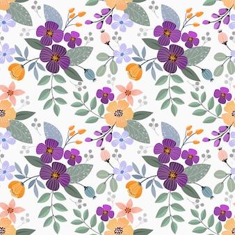 カラフルな手描きの花のシームレスなパターンデザイン。ファブリックテキスタイルの壁紙に使用できます。