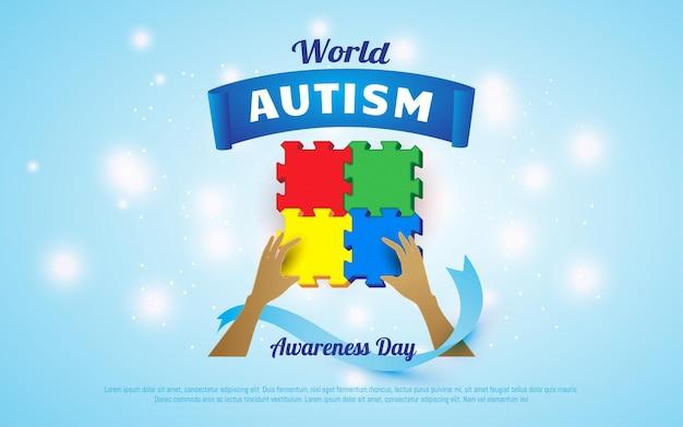 世界自閉症啓発デーのパズルのピースを持っているカラフルな手