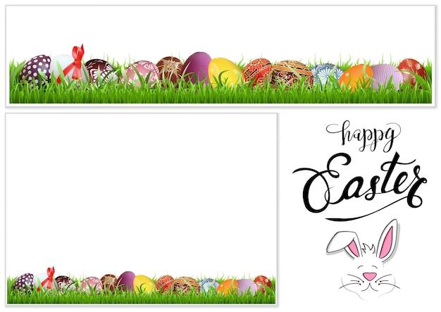 草の上のカラフルな手描きのイースターエッグ