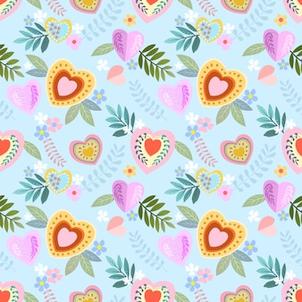 Colorful heart shape with flowers seamless pattern.