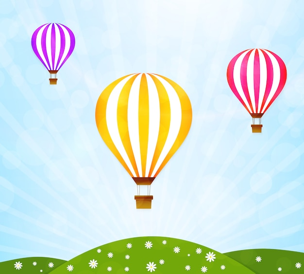 Colorful hot air balloons over the green landscape.