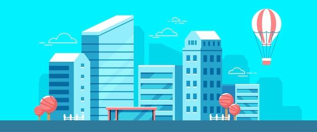 青い背景の街の風景のカラフルなイラスト