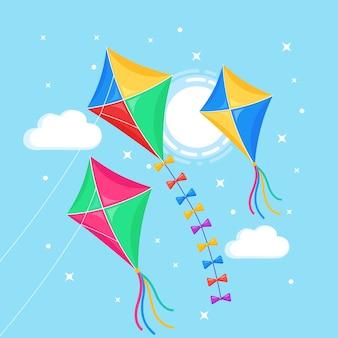 青い空を飛んでいるカラフルな凧、背景に孤立した太陽