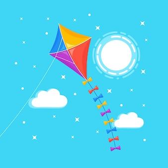 青い空を飛んでいるカラフルな凧、背景に孤立した太陽。