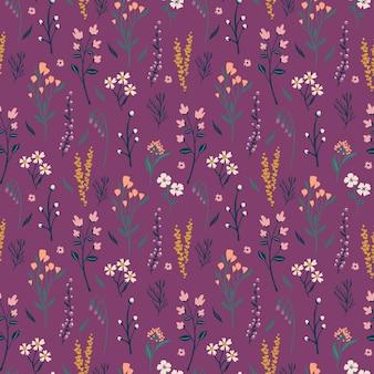 壁紙とテキスタイルのためのカラフルな牧草地の花のシームレスなパターン