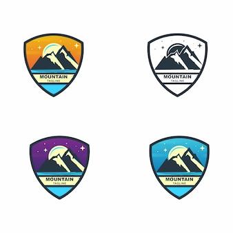 Colorful mountain adventure shield badge set