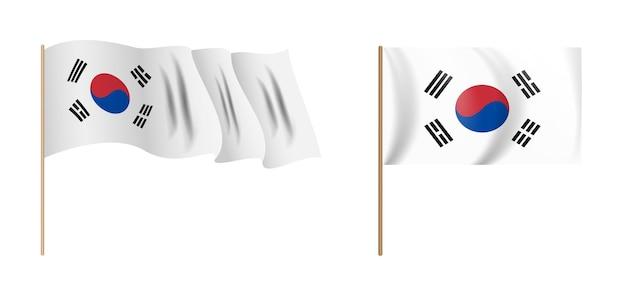 カラフルな自然主義的な手を振る韓国の旗。