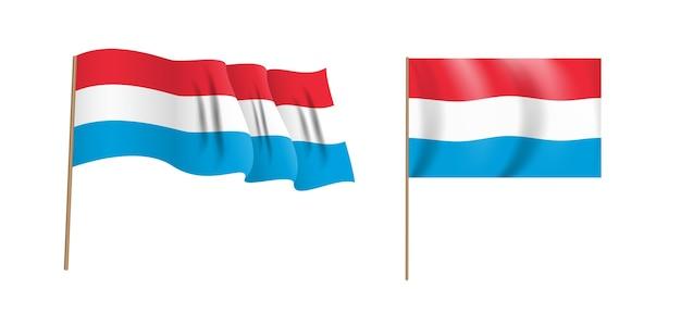 カラフルな自然主義的な手を振るルクセンブルクの旗。